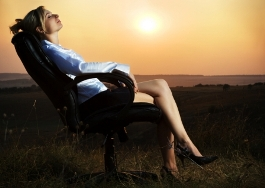 Business Woman in Chair with Sunset